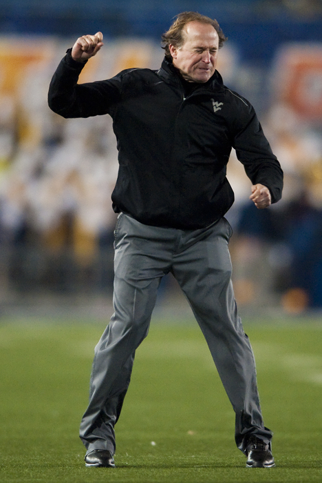West Virginia head coach Dana Holgorsen reacts to a call against Kansas State at Milan Puskar Stadium on Thursday, Nov. 20, 2014 in Morgantown, W.Va. Kansas State won 26-20.