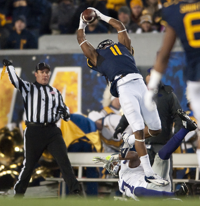 West Virginia wide receiver Kevin White (11) attempts to catch a pass over Kansas State defensive back Danzel McDaniel (7), but was called for pass interference on White, at Milan Puskar Stadium on Thursday, Nov. 20, 2014 in Morgantown, W.Va.