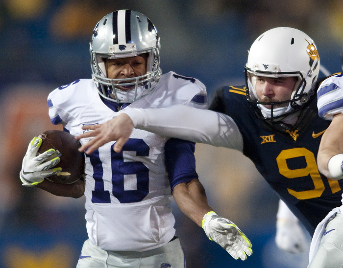 Kansas State wide receiver Tyler Lockett (16) runs an interception back for a touchdown against West Virginia defensive lineman D.J. Carozza (91) at Milan Puskar Stadium on Thursday, Nov. 20, 2014 in Morgantown, W.Va.