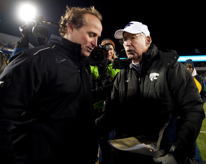 West Virginia head coach Dana Holgorsen and Kansas State head coach Bill Snyder greet each other after the game at Milan Puskar Stadium on Thursday, Nov. 20, 2014 in Morgantown, W.Va. Kansas State won 26-20.