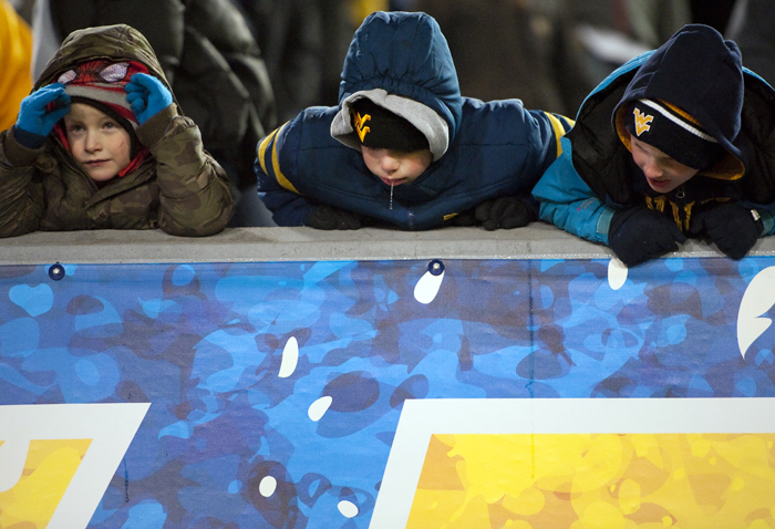 Bored West Virginia fans react to the team's losing score against Kansas State at Milan Puskar Stadium on Thursday, Nov. 20, 2014 in Morgantown, W.Va. Kansas State won 26-20.