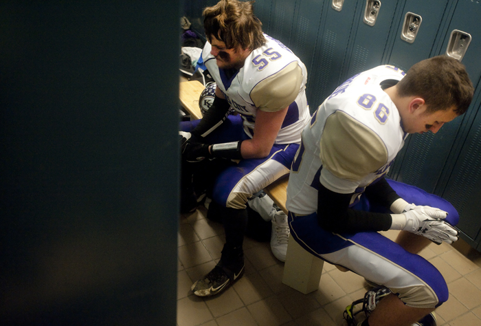 Karns City's Reese Barger (55) and Kyle Nolan rest in the locker room during halftime against Chestnut Ridge on Friday, Nov. 21, 2014 at Chestnut Ridge High School. Karns City won 23-14.