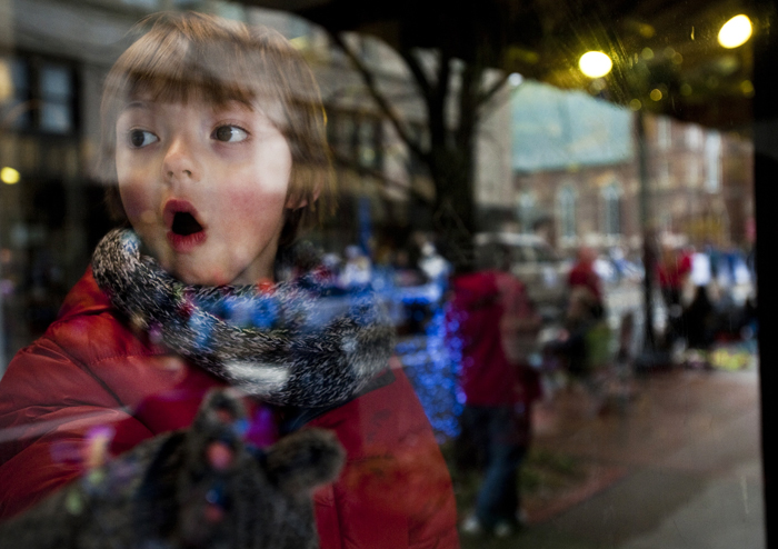 Conner Grant, 5, of Hempfield looks toward the floats inside Joseph Thomas Flower Shop during the City of Greensburg Holiday Parade on Saturday, Nov. 22, 2014.
