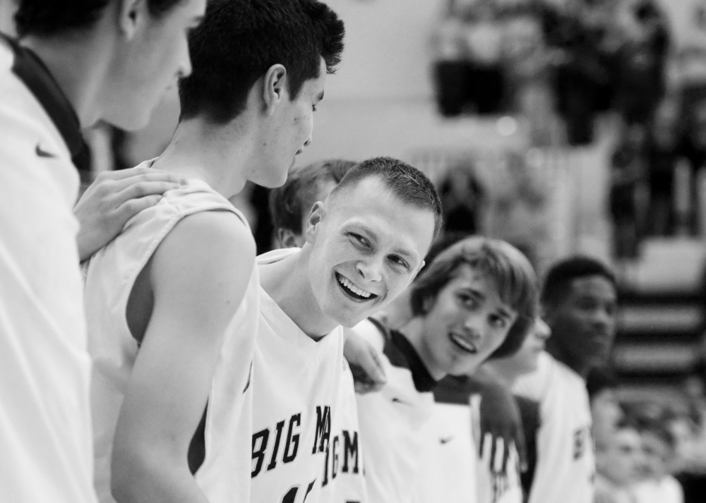 Senior Luke Blanock laughs with his friends during the national anthem before his first career varsity start one year after he first learned of his cancer diagnosis of Ewing's sarcoma on Friday, Dec. 5, 2014 at Canon-McMillan High School. The Big Macs won 77-31 over Burgettstown.