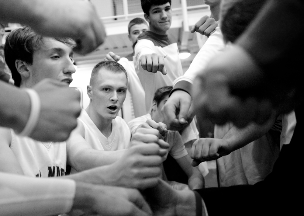 Senior Luke Blanock, center, gathers with his team in a timeout during his first career varsity start one year after he first learned of his cancer diagnosis of Ewing's sarcoma on Friday, Dec. 5, 2014 at Canon-McMillan High School. The Big Macs won 77-31 over Burgettstown.
