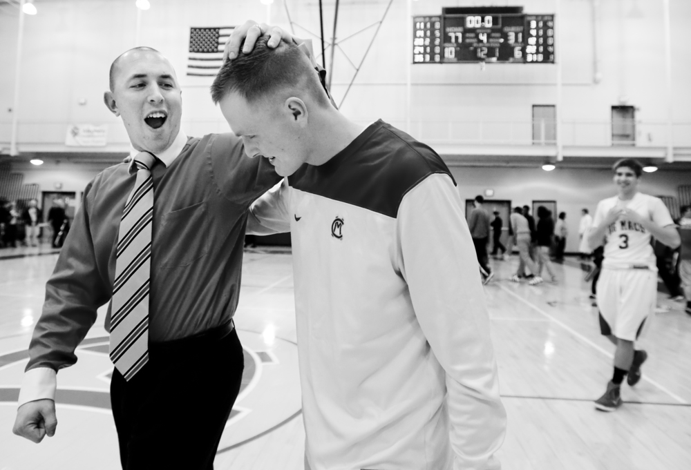 Senior Luke Blanock, center, is congratulated by coach Scott Drakeley after his first career varsity start one year after he first learned of his cancer diagnosis of Ewing's sarcoma on Friday, Dec. 5, 2014 at Canon-McMillan High School. The Big Macs won 77-31 over Burgettstown.