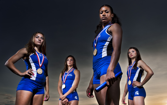 The Hempfield Area girls 4x100 meter relay team, (from left to right) Bridget Guy, Maddie Holmberg, Jasmine Jones and Gabby Holmberg, poses for a portrait on Thursday, June 19, 2014 at the high school. The team won the PIAA AAA state championship for the second straight year with a time of 47.74, which is the fifth fastest time in WPIAL history.