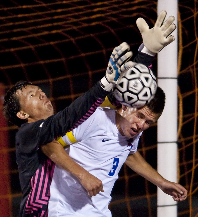 Derry goalkeeper Zack Geary makes a save over the head of Mount Pleasant's Zachary D'Amico on Thursday, Sept. 4, 2014 at Mount Pleasant High School. Derry won 2-1 in overtime.