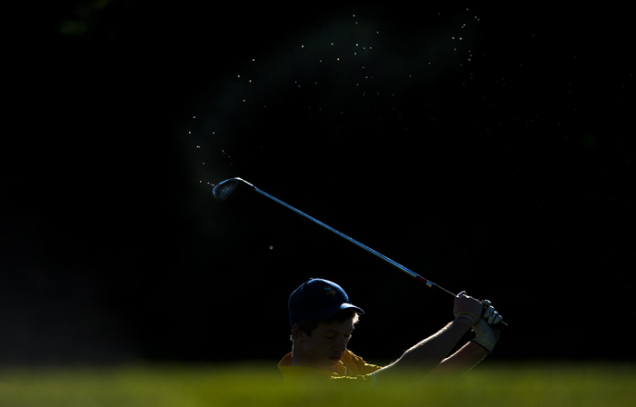 Dew sprays off the club of Pittsburgh Central Catholic's Bill Boehner as he takes a shot during the Boy's WPIAL AAA Championships on Thursday, Oct. 8, 2014 at Cedarbrook Golf Course in Belle Vernon.