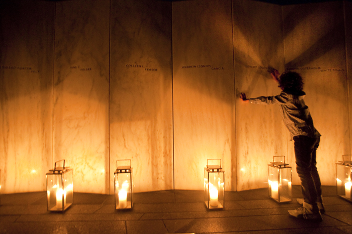 Logan Hurwitt, 11, of Bergen County, N.J., touches the name of his uncle Jeremy Glick at the Flight 93 National Memorial during a luminaria on Wednesday, Sept. 10, 2014 near Shanksville.