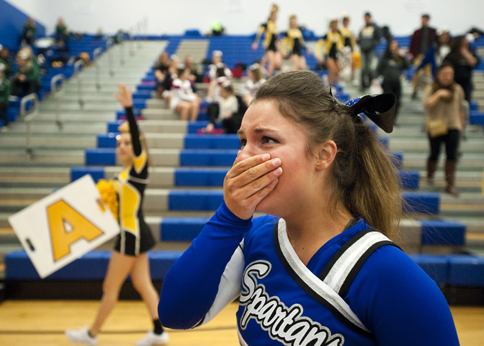 Hempfield cheerleader Marley Lucas reacts after competing in the WPIAL Competitive Spirit championships on Saturday, Jan. 10, 2015 at Hempfield Area High School.