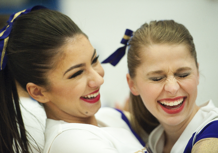 Plum cheerleaders Allison Mazur, right, and Nikki Gilboy hug before competing in the WPIAL Competitive Spirit championships on Saturday, Jan. 10, 2015 at Hempfield Area High School.