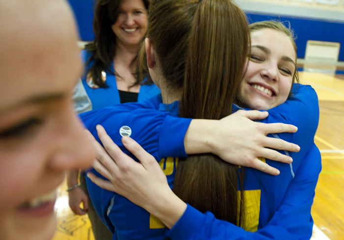 Derry's Madison Deluca receives a hug during senior day festivities before playing Laurel Highlands on Thursday, Jan. 29, 2015. Laurel Highlands won 50-39.