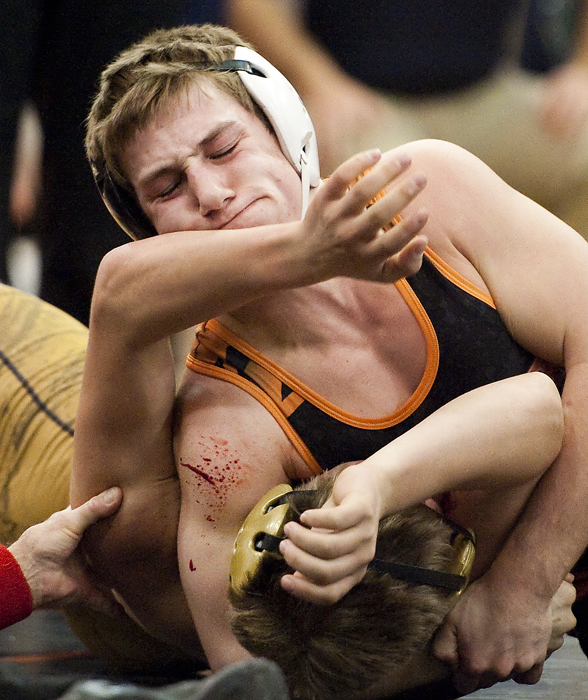 Latrobe's Luke Pletcher grabs a hold of Kiski's Mason Valore during the WPIAL quarterfinals at Latrobe High School on Wednesday, Jan. 28, 2015. Latrobe won 34-27.