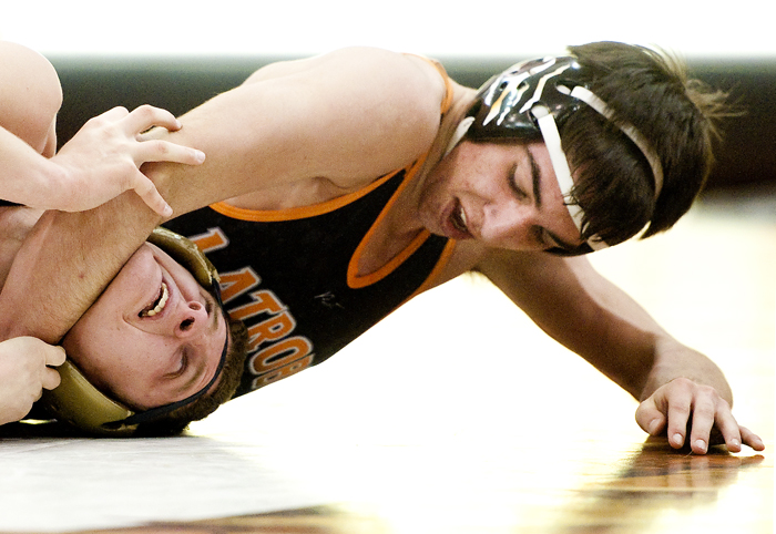 Latrobe's Jake Willochell grabs a hold of Kiski's Vaughn Curcio during the WPIAL quarterfinals at Latrobe High School on Wednesday, Jan. 28, 2015. Latrobe won 34-27.