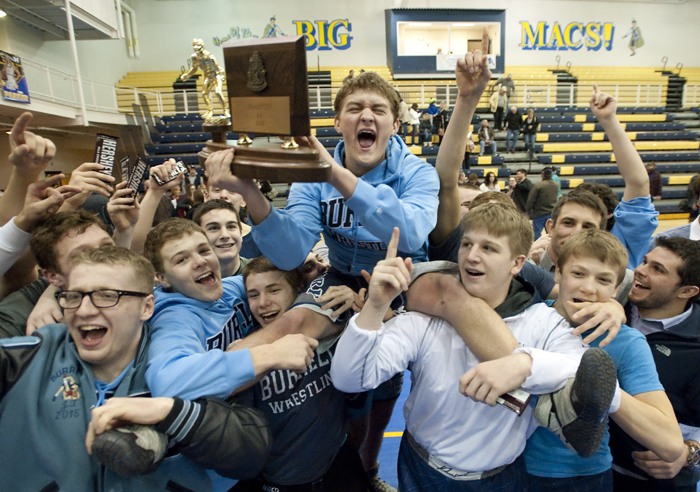 Burrell hoists Robert Hickman as the team celebrates their ninth AA WPIAL championship in a row by defeating McGuffey 38-25 on Saturday, Jan. 31, 2015 at Canon-McMillan.