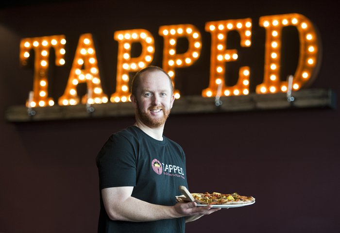 Co-owner Eric Jones poses for a portrait at his and his wife's new restaurant Tapped Brick Oven and Pour House in Greensburg on Friday, Jan. 16, 2015. The restaurant opened Jan. 5, 2015.