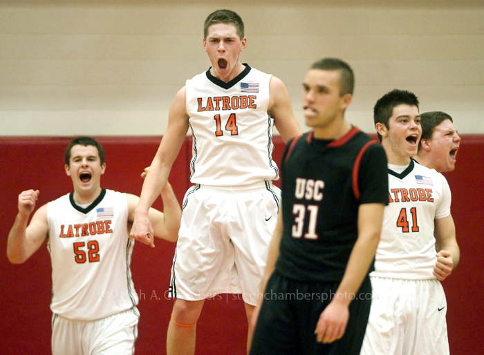 Latrobe's Tommy Kisick (52), Matt Dragon (14), Sean Graytok (41) and Seth Holler (far right) celebrate as Upper St. Clair's Andrew Wheeler reacts after a call against Upper St. Clair as during the first round of AAAA WPIAL boys basketball playoffs on Saturday, Feb. 14, 2015 at Charleroi Area High School. Upper St. Clair won 61-59.