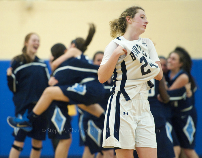 Burrell's Natalie Myers walks off the court as Bishop Canevin celebrates their 32-30 win during the WPIAL semifinal AA girls basketball game on Tuesday, Feb. 24, 2015 at Hampton High School.
