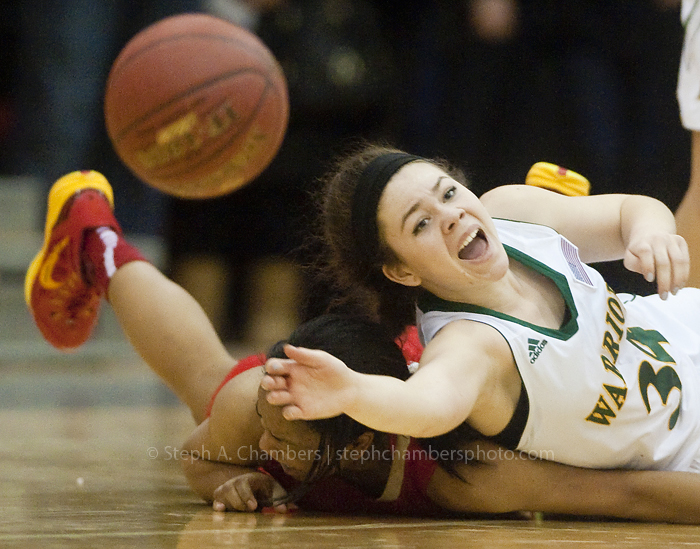 Penn-Trafford's Katy Abreu calls for a teammate as she passes the ball over Penn Hills' Jade Ely during the WPIAL girls AAAA playoffs on Friday, Feb. 20, 2015 at Gateway High School. Penn Hills won 40-22.