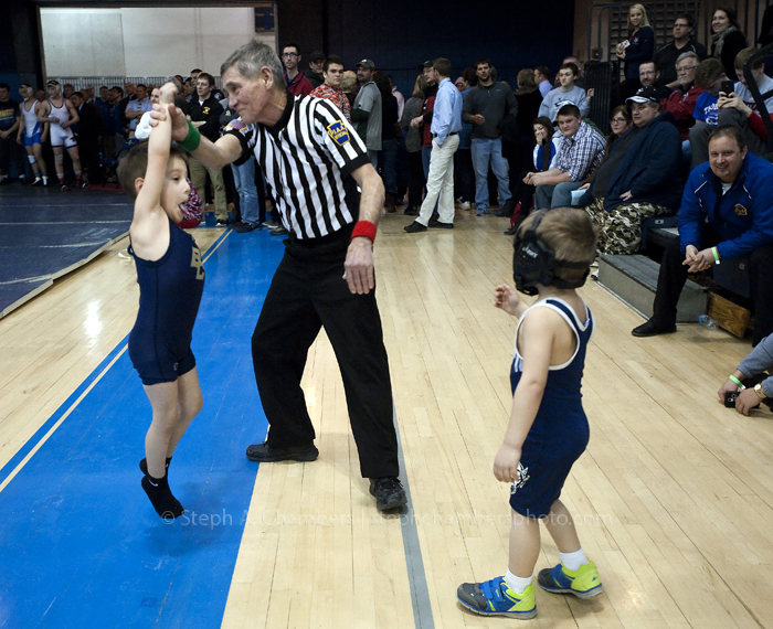 Longtime PIAA official Ted Gonder of Claridge playfully raises the arm of Enzo Brown, 5, of Bethlehem-Center as his newly befriended opponent Damien Foster, 4, of Burgettstown looks on during the championship day of the Southwest Regional Class AA wrestling tournament on Saturday, Feb. 28, 2015 at Canon-McMillan High School.
