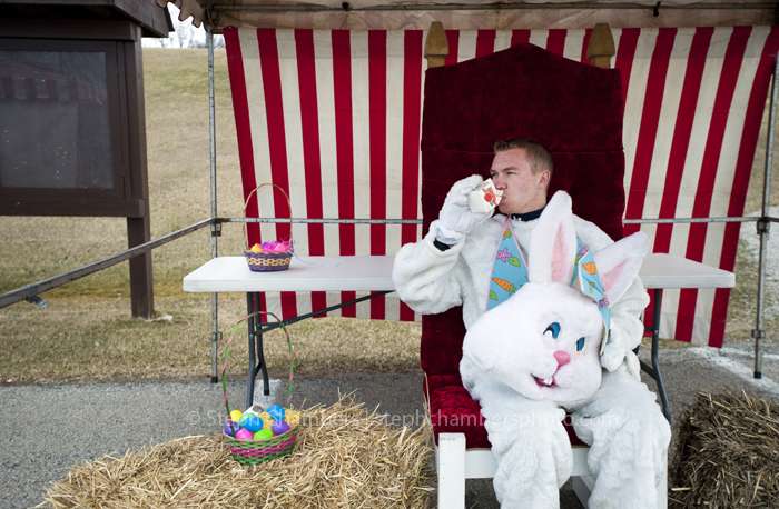 Trey Quealy, 17, a senior at Norwin High School, takes an orange juice break between posing for pictures during an Easter Eggapalooza at Oak Hollow Park in Irwin on Saturday, March 28, 2015. Though there were a few flurries, organizers said 300 people attended the event.