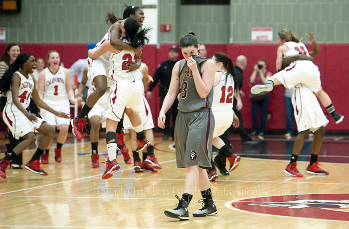 Bloomsburg's Jocelyn Ford reacts as California celebrates their win during the NCAA Division II Atlantic Region championship game on Monday, March 16, 2015 in California, Pa. California won 72-69 in overtime.