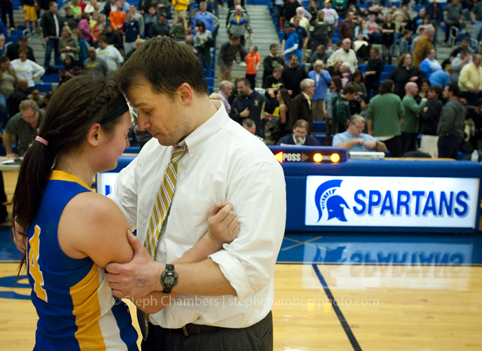 Seton-La Salle head coach Spencer Stefko consoles Bellwood-Antis' Ana Hollen after the PIAA quarterfinal on Friday, March 13, 2015 at Hempfield Area High School. Seton-La Salle won 63-60.