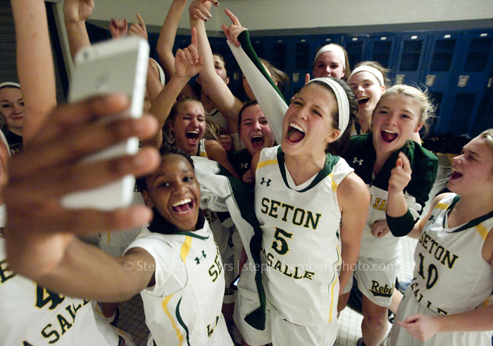 "Seton-La Salle's Shaunay Edmonds takes a ""selfie"" with her teammates in the locker room after their come from behind win over Greensburg Central Catholic during a PIAA game on Tuesday, March 10, 2015 at Canon-McMillan High School. Seton-La Salle won 54-52."
