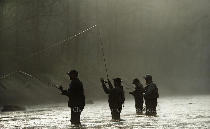 From left to right, Jim Malik of Hempfield, Mike Kozain of Manor, Johnny Fry of Irwin and John Fry of Irwin fish in the morning fog on Saturday, April 18, 2015 along the Loyalhanna Creek near Ligonier. Saturday at 8 a.m. marked the opening day of trout season.