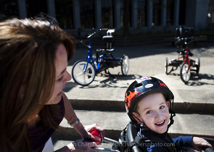 Max Petrof, 8, of Ligonier smiles back to his mother Anne after the charity group Variety presented custom-made bicycles to five local special needs kids on Tuesday, April 28, 2015 outside the Westmoreland County Courthouse in Greensburg.