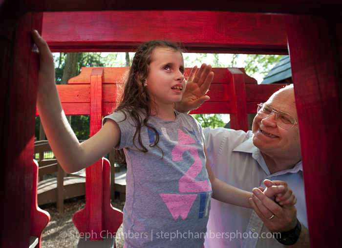 Alyssa Yushak, 9, of Latrobe feels a play trolley with the encouragement of her grandfather Wayne Rhodes of Youngstown on Tuesday, May 19, 2015 at Legion-Keener Park in Latrobe. Though Yushak is blind, the feelings of slides, swings and jungle gyms make parks one of her favorite places to have fun.