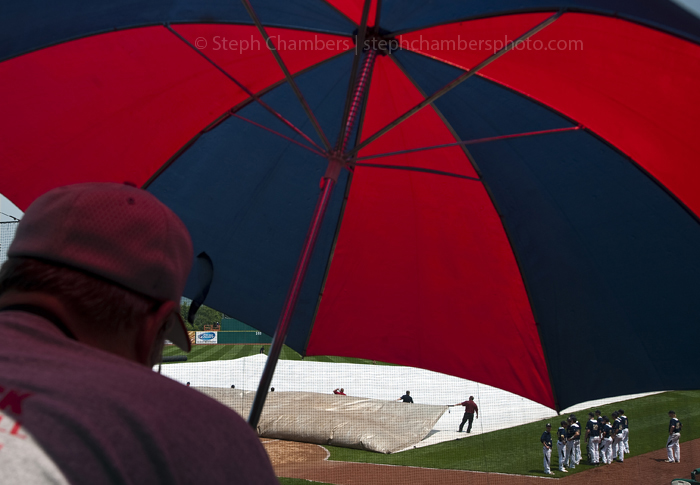 David Cain of New Castle watches the field crew remove a tarp after a rain delay in the Knoch versus Abington Heights PIAA Class AAA baseball title game at Penn State's Medlar Field at Lubano Park on Friday, June 12, 2015. Knoch won 7-5.
