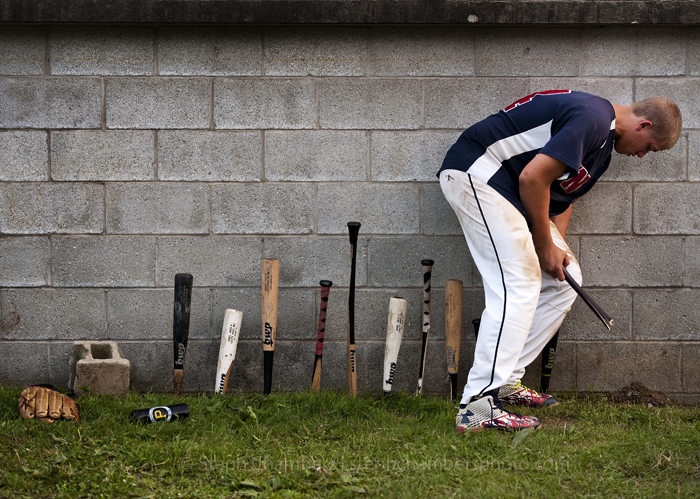 "Unity's Doug Cengia adds to his team's ""baseball bat graveyard"" after an American Legion game against Latrobe on Friday, June 26, 2015 in Whitney. Latrobe won 11-0."
