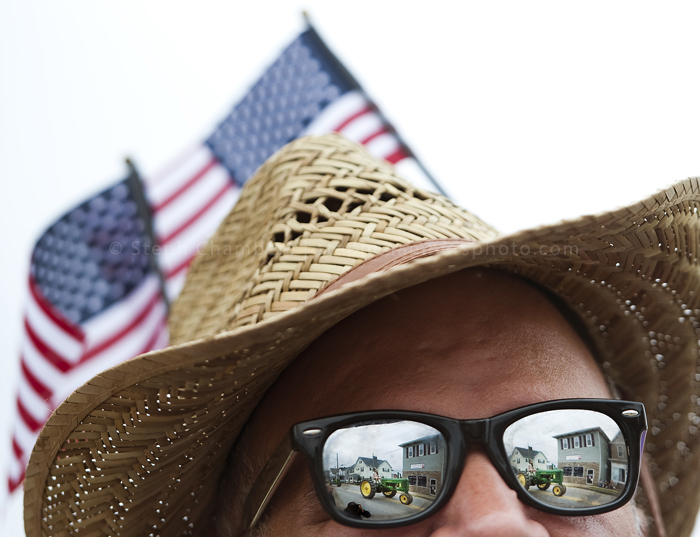 John Clarchick of Greensburg watches a fleet of antique John Deere tractors roll along during the 4th of July Parade on Saturday, July 4, 2015 in Latrobe.