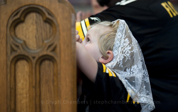 Caroline Tressler, 5, of Grapeville kneels and prays for the Pittsburgh Steelers during a Black and Gold service on Sunday, July 26, 2015 at St. Vincent Basilica in Latrobe before the first day of Pittsburgh Steelers training camp.