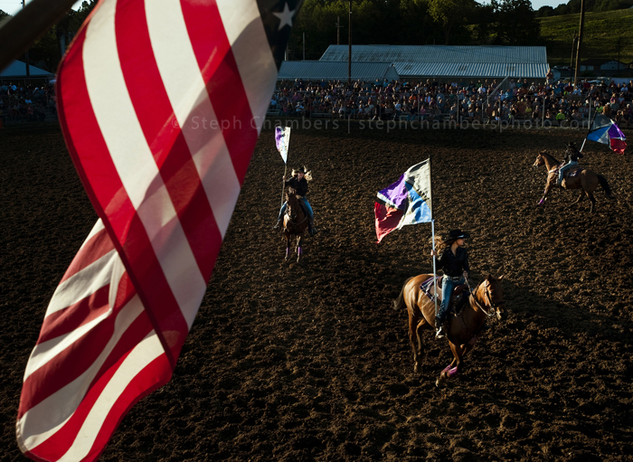 Riders carry flags before a rodeo during the Bullskin Township Community Fair on Wednesday, Aug. 19, 2015 in Wooddale.