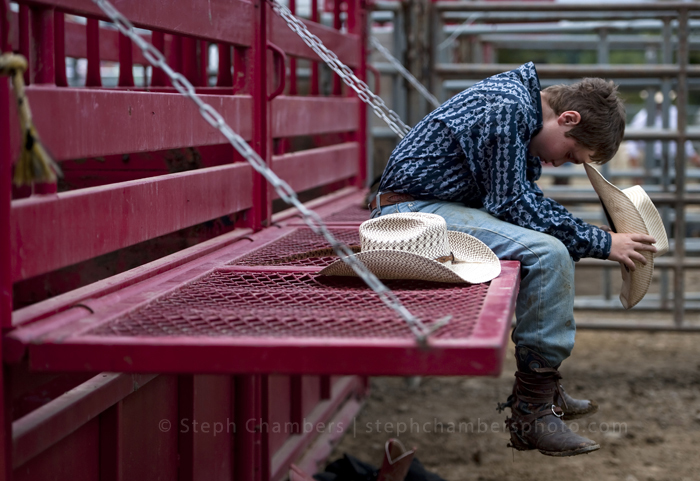 Hunter Rahm, 12, of Uniontown pauses for a moment during a rodeo at the Fayette County Fair on Thursday, Aug. 6, 2015 in Dunbar.