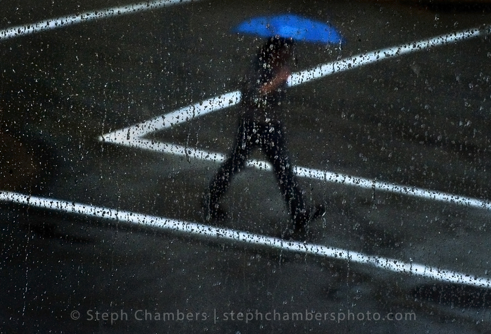 A pedestrian crosses Ligonier Street in Latrobe during a soggy Tuesday, Sept. 29, 2015.
