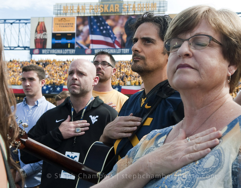 Country musician Brad Paisley, born in Glen Dale, W.Va., listens to the national anthem an NCAA football game between West Virginia Mountaineers and Maryland Terrapins on Saturday, Sept. 26, 2015 at Milan Puskar Stadium in Morgantown, W.Va. WVU won 45-6.