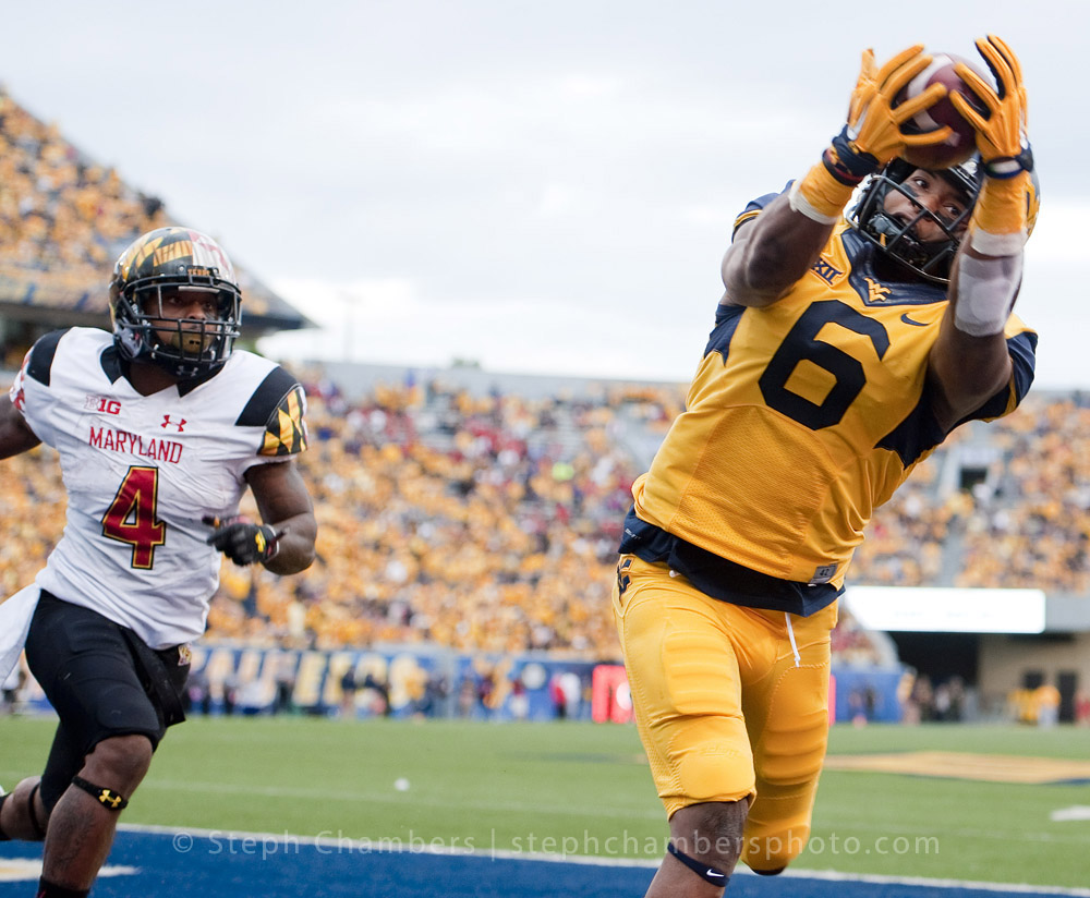 West Virginia wide receiver Daikiel Shorts (6) catches a touchdown pass next to Maryland Terrapins defensive back William Likely (4) during an NCAA football game on Saturday, Sept. 26, 2015 at Milan Puskar Stadium in Morgantown, W.Va. WVU won 45-6.