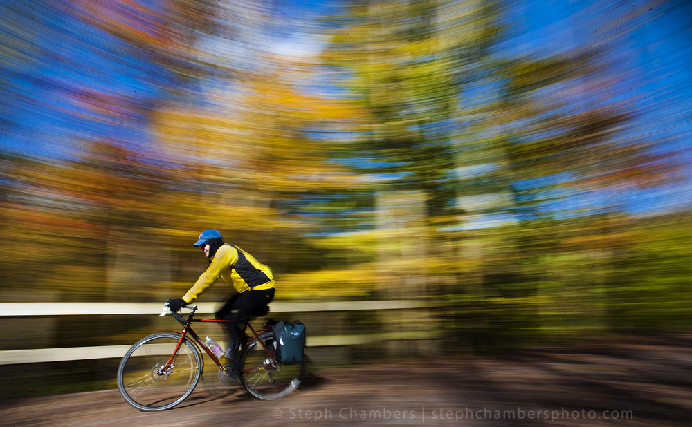 A biker rides along the Great Allegheny Passage past fall foliage in Ohiopyle State Park on Sunday, Oct. 18, 2015.