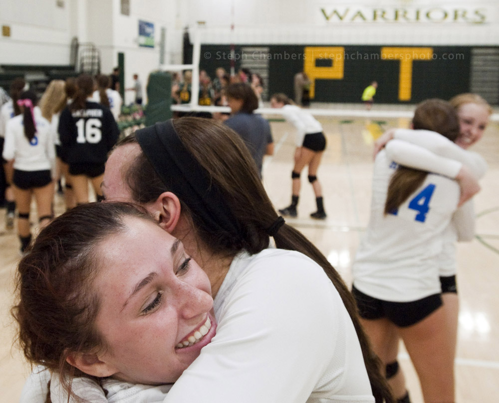 Hempfield's Emma Pevarnik receives a hug from Gabby Holmberg after beating Penn-Trafford during a volleyball game on Tuesday, Oct. 20, 2015 at Penn-Trafford High School. Hempfield won.