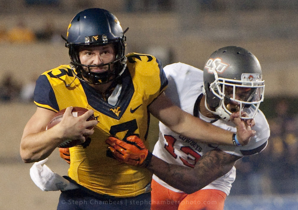 West Virginia quarterback Skyler Howard (3) rushes past Oklahoma State safety Jordan Sterns (13) on Saturday, Oct. 10, 2015 at Milan Puskar Stadium in Morgantown, W.Va. Oklahoma State won 33-26 in overtime.
