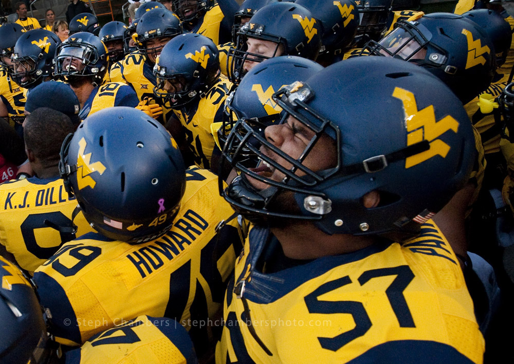 West Virginia offensive lineman Adam Pankey (57) amps up with his team before playing Oklahoma State on Saturday, Oct. 10, 2015 at Milan Puskar Stadium in Morgantown, W.Va. Oklahoma State won 33-26 in overtime.