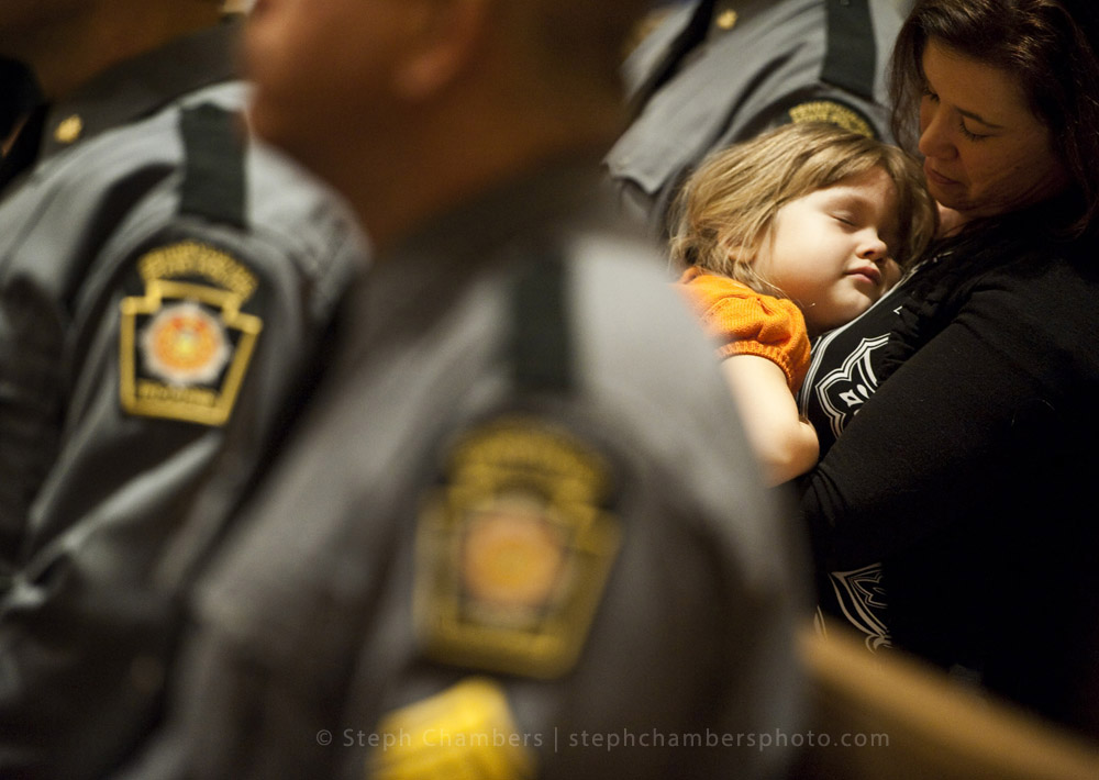 "Maren Newcaster, 4, of Jeannette sleeps on her mother Amber as the choir sings ""Be Still My Soul"" during the third Diocese of Greensburg's First Responders Prayer Service at Blessed Sacrament Cathedral on Thursday, Oct. 22, 2015. Newcaster is the daughter of Lt. Nick Newcaster of the state police."