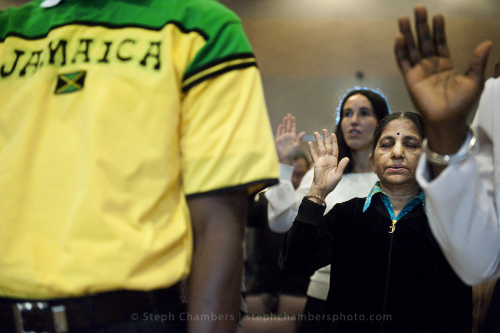 Kokilaben Patel of India closes her eyes and holds up her right hand as she takes an oath of allegiance during a naturalization ceremony on Friday, Oct. 23, 2015 at Indiana University of Pennsylvania's Kovalchick Convention Center-Toretti Auditorium. The ceremony granted citizenship for 101 candidates from 44 countries, who live in the greater Pittsburgh area.