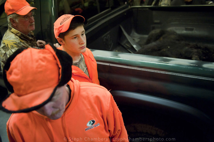 Gordon Matson, 17 of Ligonier waits with other hunters while his bear is weighed at the Pennsylvania Game Commission Southwest Region Office on Saturday, Nov. 21, 2015, in Bolivar.