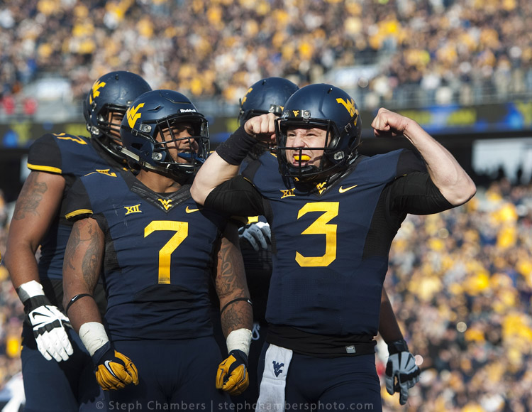 West Virginia quarterback Skyler Howard (3) reacts after his touchdown against Texas Tech on Saturday, Nov. 7, 2015, at Milan Puskar Stadium in Morgantown, W.Va. WVU won 31-26.