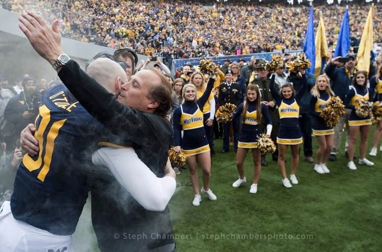West Virginia head coach Dana Holgerson greets West Virginia punter Nick O'Toole (91) during senior day festivities before playing Iowa State on Saturday, Nov. 28, 2015, at Milan Puskar Stadium in Morgantown, W.Va. WVU won 30-6.